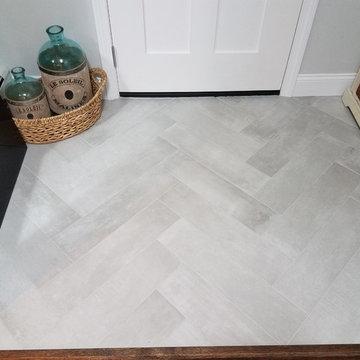 Beautiful herringbone pattern tile entry