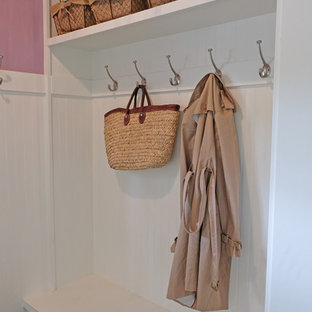 Mudroom - small transitional ceramic tile mudroom idea in Chicago with purple walls