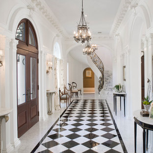 Design ideas for a large classic foyer in Jacksonville with white walls, a double front door, a dark wood front door, marble flooring and multi-coloured floors.