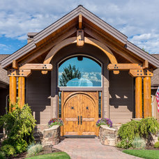 Rustic Entry by Sun Forest Construction