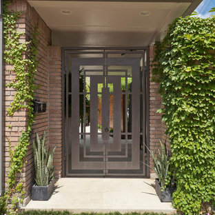Example of a midcentury modern entryway design in Houston
