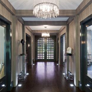 Foto di un grande corridoio design con pareti con effetto metallico, parquet scuro, una porta a due ante e una porta in legno scuro