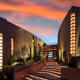 Entryway - southwestern entryway idea in Phoenix with a glass front door