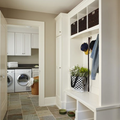 Inspiration for a mid-sized timeless slate floor and beige floor mudroom remodel in Detroit with beige walls