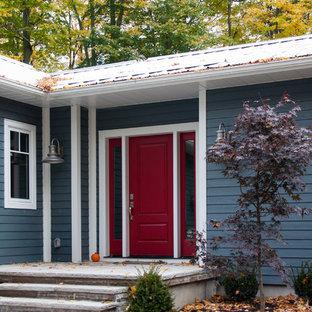 Esempio di una porta d'ingresso chic con una porta singola e una porta rossa