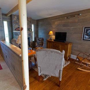 Foyer - mid-sized rustic medium tone wood floor foyer idea in Other