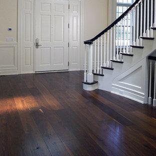 Entryway - contemporary brown floor entryway idea in Chicago