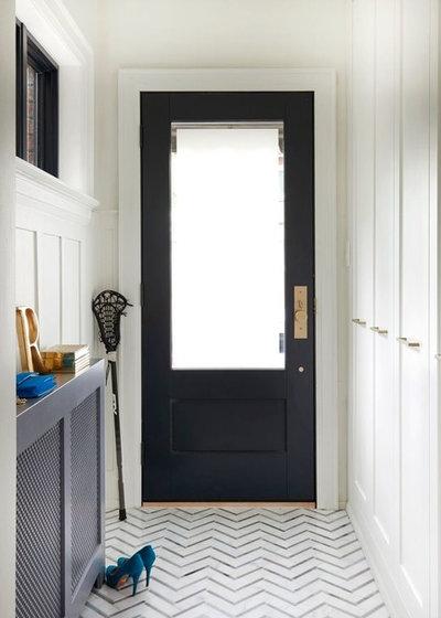 Modern Entrance by Meghan Carter Design Inc.