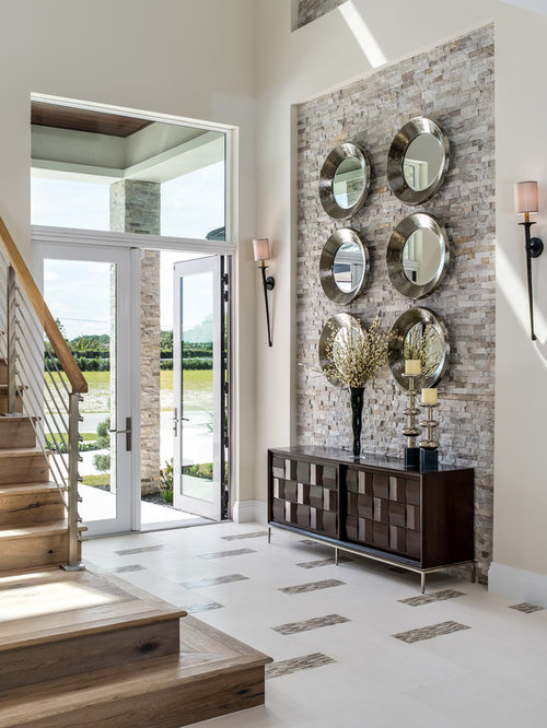Example Of A Large Transitional White Floor And Porcelain Floor Entryway  Design In Miami With Beige