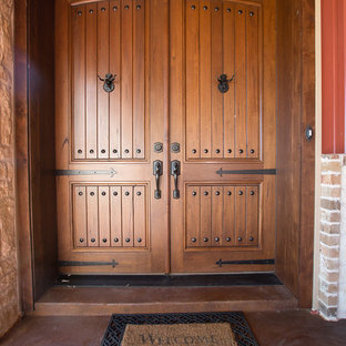 Inspiration for a mid-sized rustic entryway remodel in Dallas with red walls and a medium wood front door