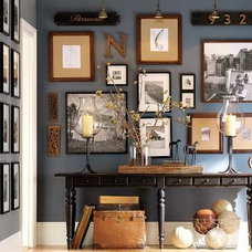 entry blue wall with photos