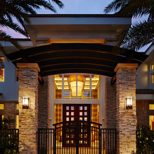 Large contemporary front door in Miami with a double front door and a glass front door.