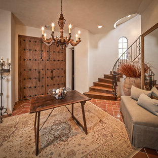 Example of a tuscan terra-cotta floor entryway design in Houston