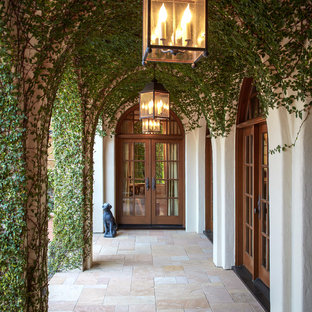 Inspiration for a mediterranean double front door remodel in Houston with a glass front door