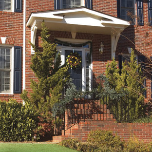 Example of a small classic entryway design in Atlanta with a black front door