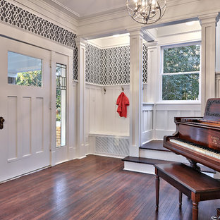 Inspiration for a traditional entryway in Austin with dark hardwood floors, a single front door and a white front door.
