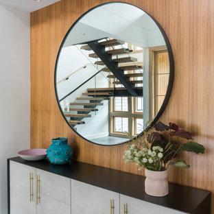 Idéer för en stor modern foajé, med vita väggar, klinkergolv i keramik, en enkeldörr, grått golv och en svart dörr