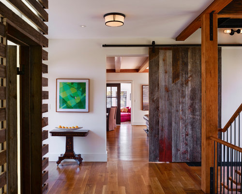 Farmhouse entryway idea in Philadelphia with medium tone hardwood floors - Reclaimed Wood Barn Door Houzz