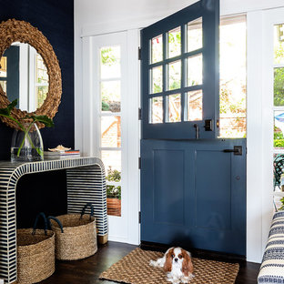 Inspiration for a mid-sized beach style dark wood floor entryway remodel in Sacramento with white walls and a blue front door
