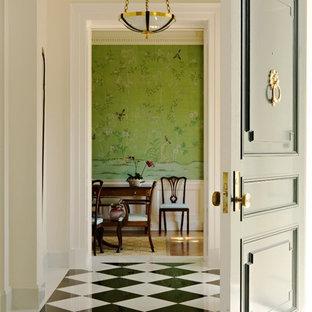 Aménagement d'une entrée classique avec un mur beige, une porte simple, un sol en marbre et un sol multicolore.