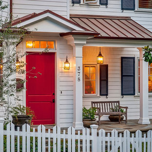 Example of a classic entryway design in Los Angeles with a red front door