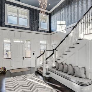 Foto på en eklektisk foajé, med grå väggar, mörkt trägolv, en enkeldörr, en vit dörr och brunt golv