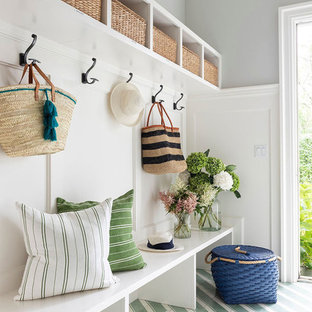 Beach style painted wood floor and multicolored floor mudroom photo in Other with gray walls