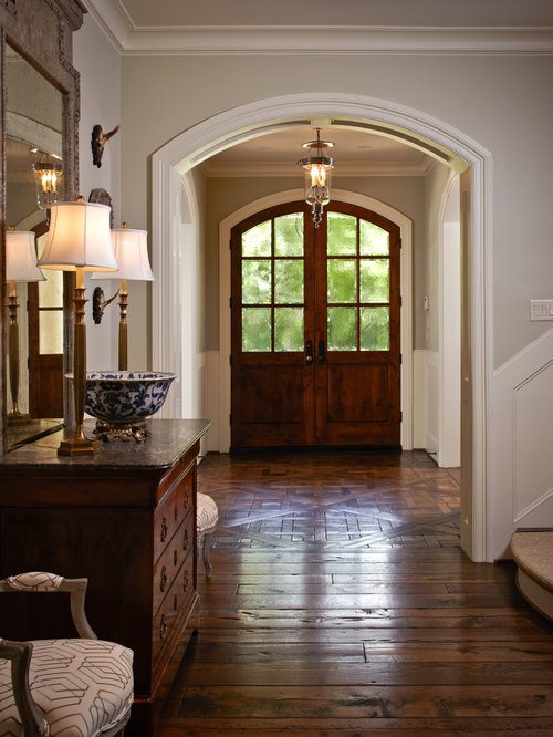 dark brown wood floors. Mid sized traditional brown floor and dark wood entryway idea in  Houston with a Medium Brown Wood Floors Houzz