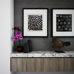 Inspiration for a large modern ceramic floor and gray floor entryway remodel in Melbourne with a white front door and black walls