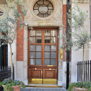 Photo of a classic front door in London with a double front door and a glass front door.