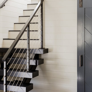 Mid-sized trendy slate floor entryway photo in Boston with white walls and a glass front door