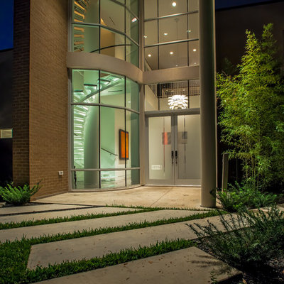 Example of a trendy entryway design in Dallas with a glass front door