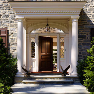 This is an example of a traditional front door in Philadelphia with a single front door and a black front door.