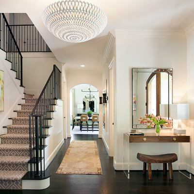 Inspiration for a mid-sized transitional dark wood floor foyer remodel in Dallas with white walls and a medium wood front door