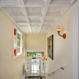 Example Of A Classic Entryway Design In San Francisco With Beige Walls
