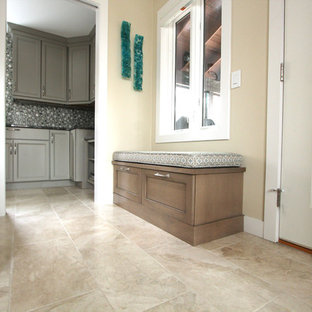 Inspiration for a small transitional travertine floor and beige floor entryway remodel in Other with beige walls and a white front door