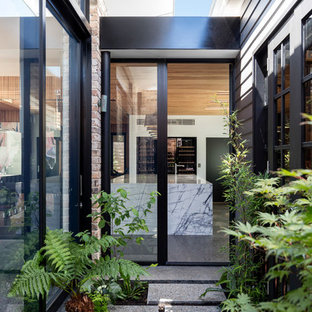 Design ideas for a contemporary front door in Wollongong with a glass front door.