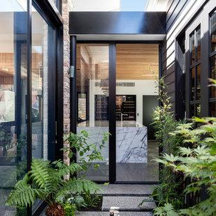 Diseño de puerta principal contemporánea con puerta de vidrio