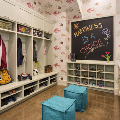 Example of a mid-sized transitional concrete floor mudroom design in Austin with multicolored walls