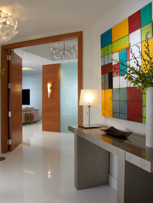 Example of a mid-sized trendy white floor and marble floor vestibule design  in Miami
