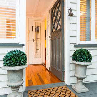 Entryway - traditional entryway idea in Brisbane with a gray front door