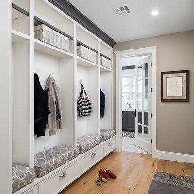 Mid-sized transitional light wood floor mudroom photo in Phoenix with beige walls