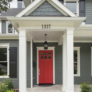 Esempio di un ingresso o corridoio chic con una porta rossa