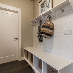 Example of a classic dark wood floor entryway design in Salt Lake City with beige walls and a white front door