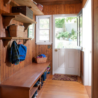 Inspiration for a mid-sized cottage medium tone wood floor entryway remodel in Los Angeles with a white front door
