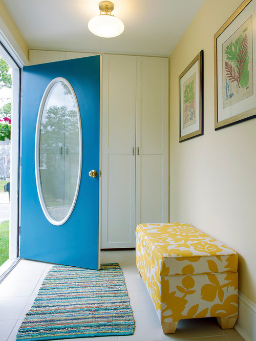 Inspiration For A Beach Style Entryway Remodel In Boston With Beige Walls  And A Blue Front
