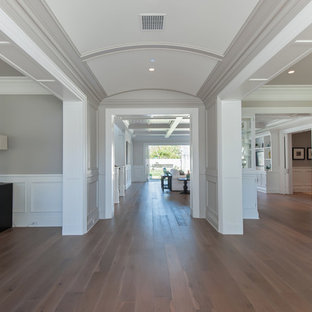 Entryway - large traditional medium tone wood floor entryway idea in Los Angeles with gray walls and a blue front door
