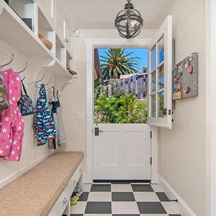 Mid-sized elegant linoleum floor and multicolored floor mudroom photo in San Diego with beige walls
