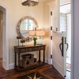 Inspiration for a beach style dark wood floor entryway remodel in Los Angeles with beige walls and a white front door