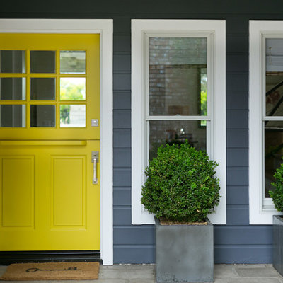Transitional entryway photo in Orange County with a yellow front door